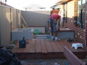 Jarrah timber on top of ponds to neaten things off.